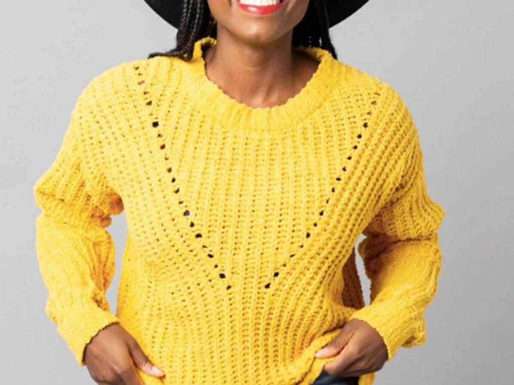 woman wearing a yellow knit sweater