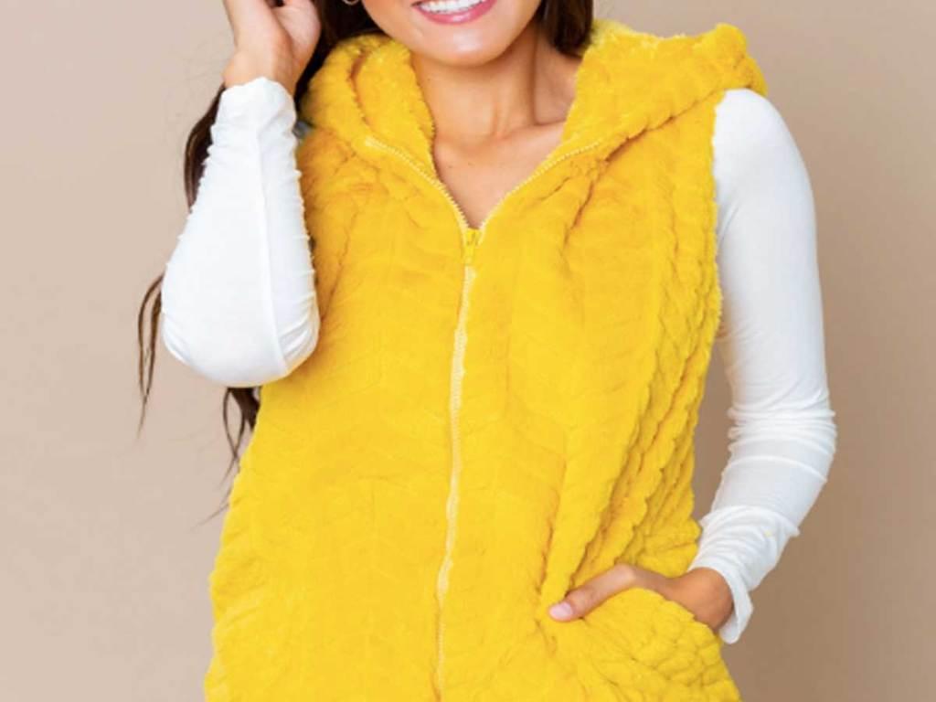 woman wearing a yellow fur vest