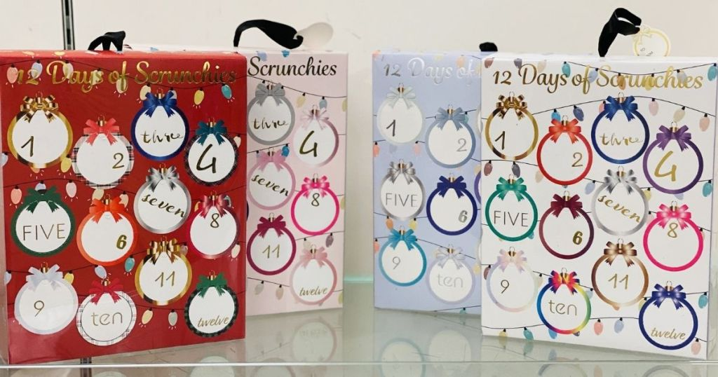red pink blue and white 12 Days of Scrunchies Advent Calendars on glass shelf