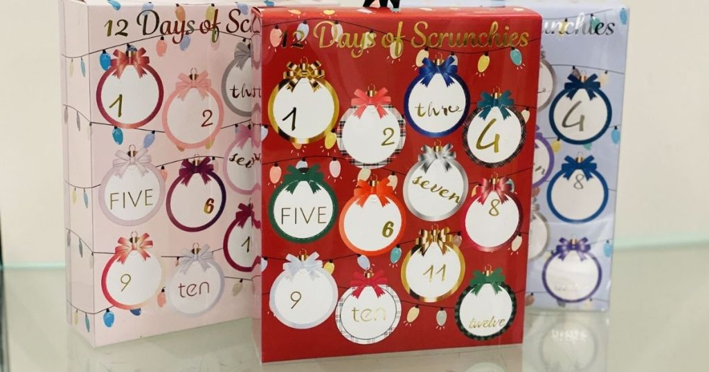 12 Days of Scrunchies Advent Calendars pink red and blue displayed on glass shelf