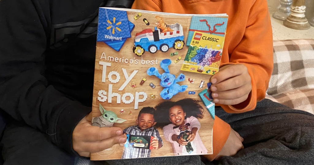 two boys holding the walmart 202 toy catalog
