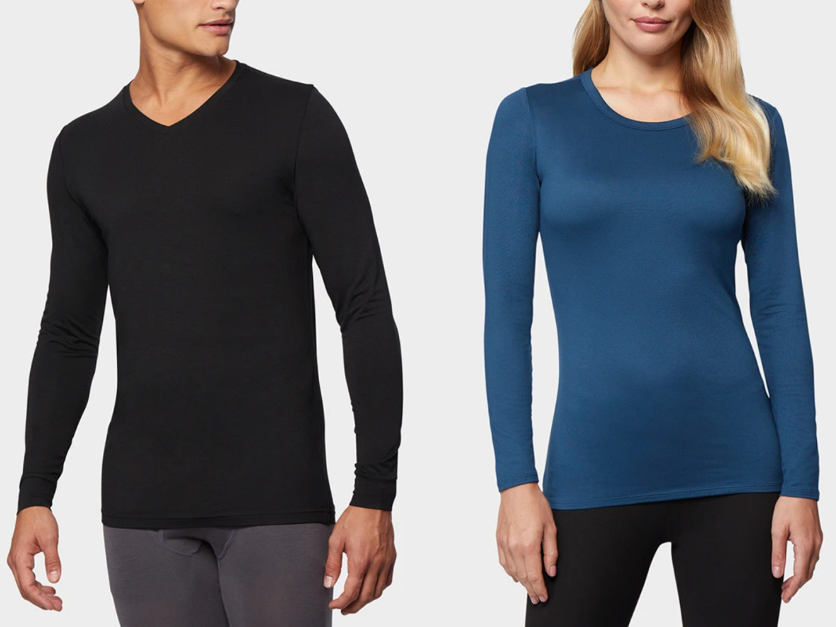 man and woman standing next to each other wearing dark colored baselayer tees