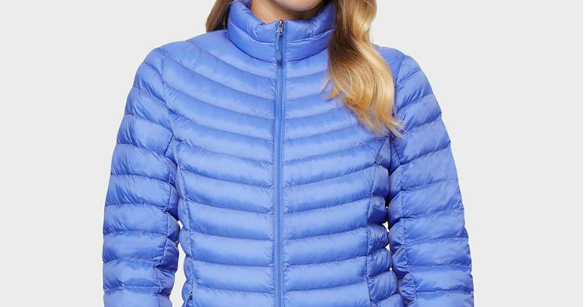 woman wearing vibrant blue puffer jacket