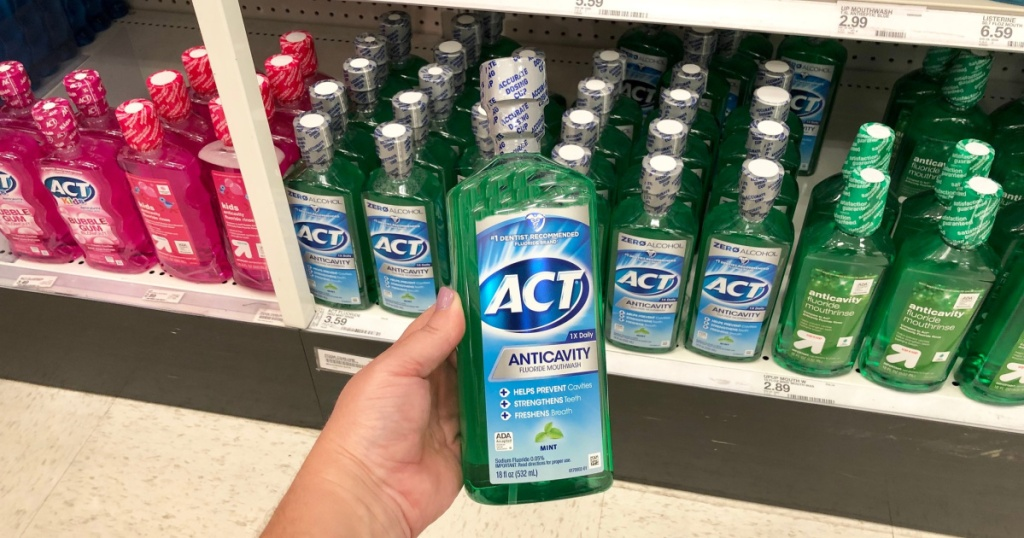 ACT mouthwash in hand in store