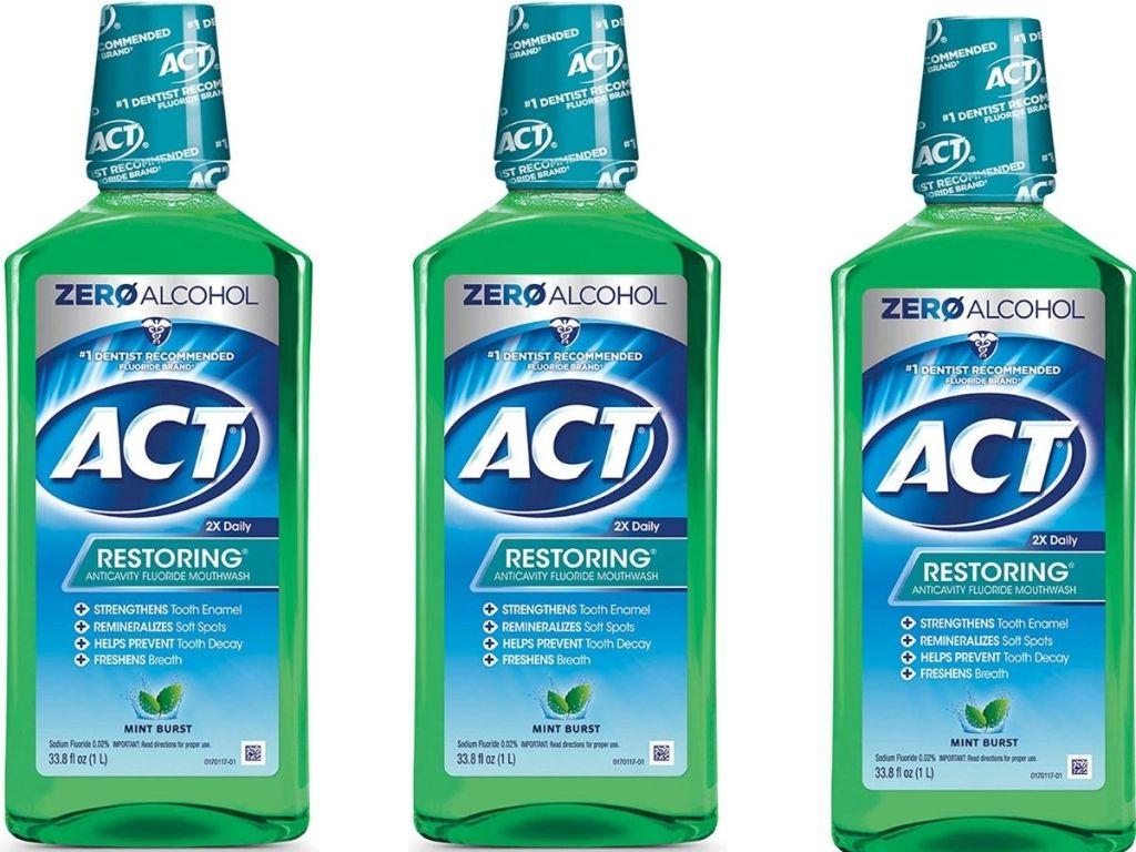 Three bottles of ACT Restoring Mouthwash