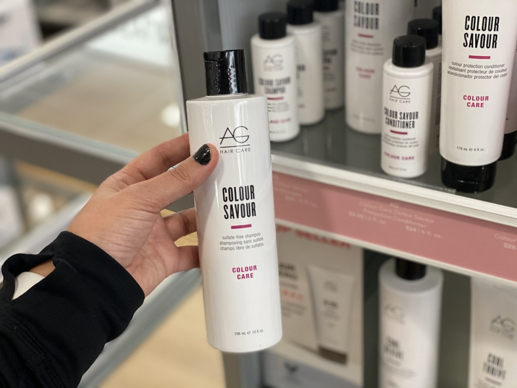 hand holding bottle of AG Colour Savour Shampoo