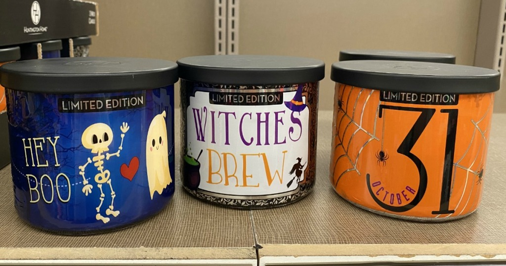 Three ALDI 3 wick candles on a store shelf