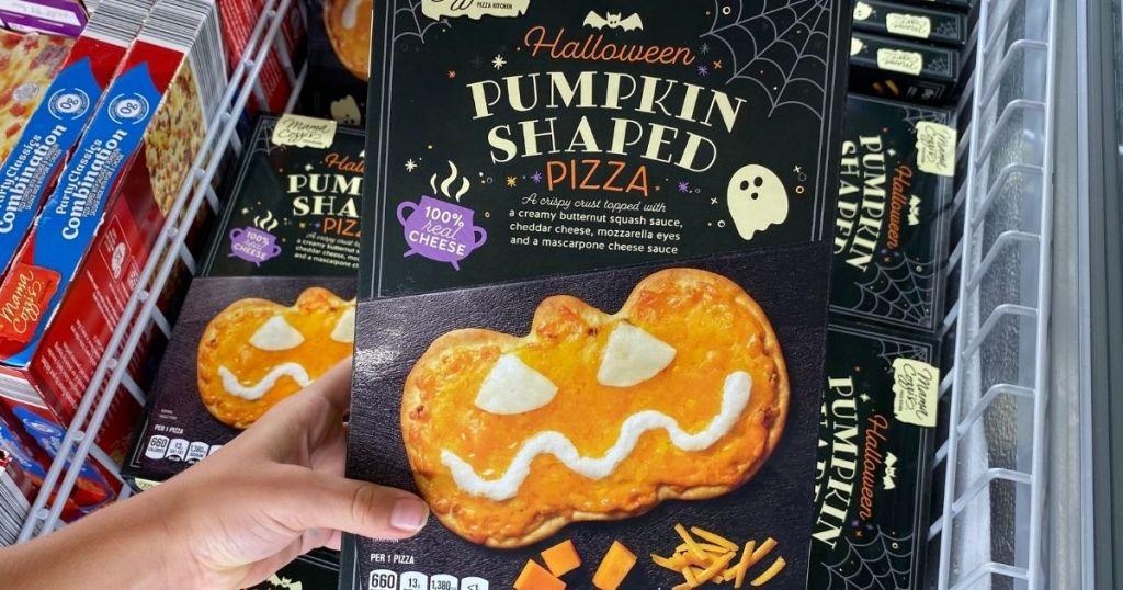 hand holding an ALDI Halloween Pizza