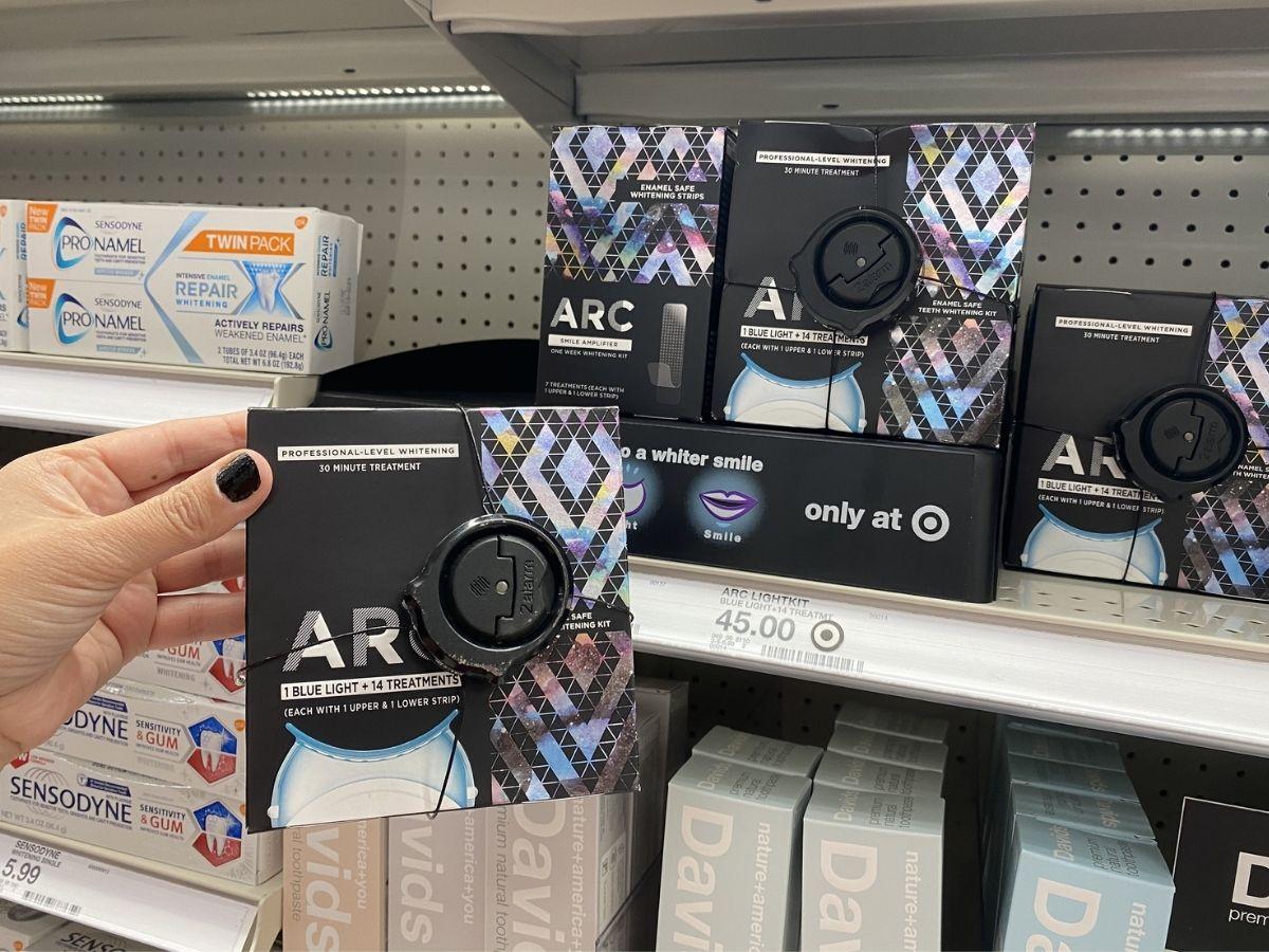 hand holding ARC Whitening Kit in store