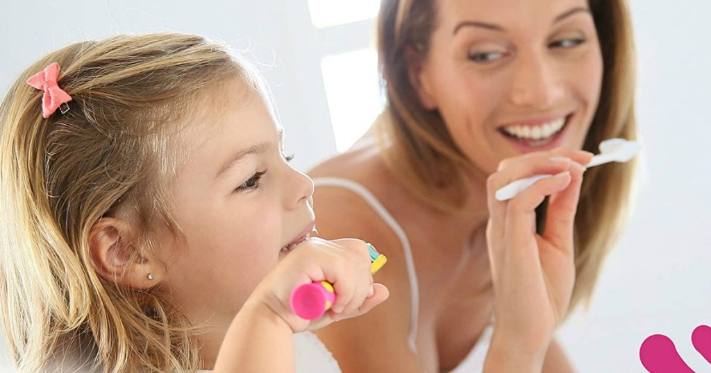 lady and her little girl brushing teeth