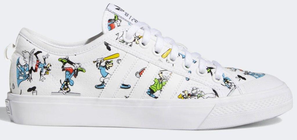 white adidas sneaker with disney goofy print and three white stripes on side