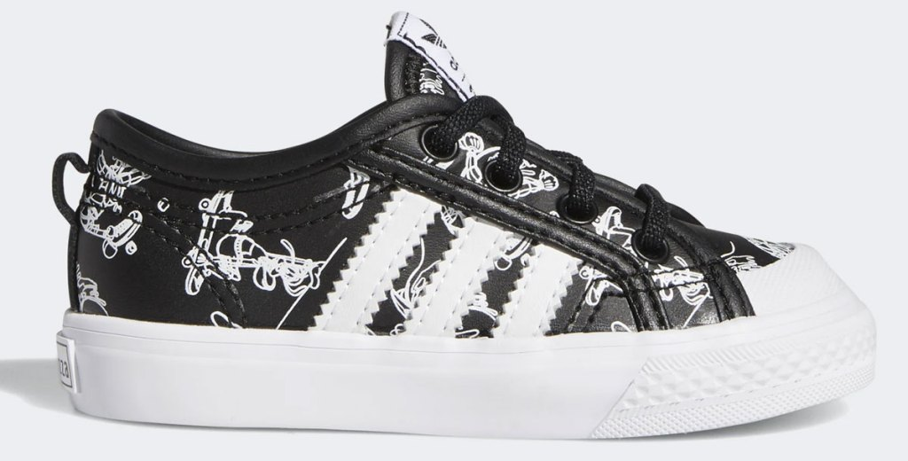 black adidas sneaker with disney goofy print and three white stripes on side