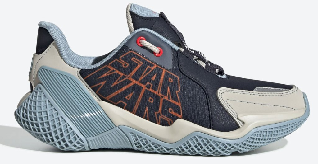 kids adidas sneaker in black and cream with orange star wars logo and blue rubber sole
