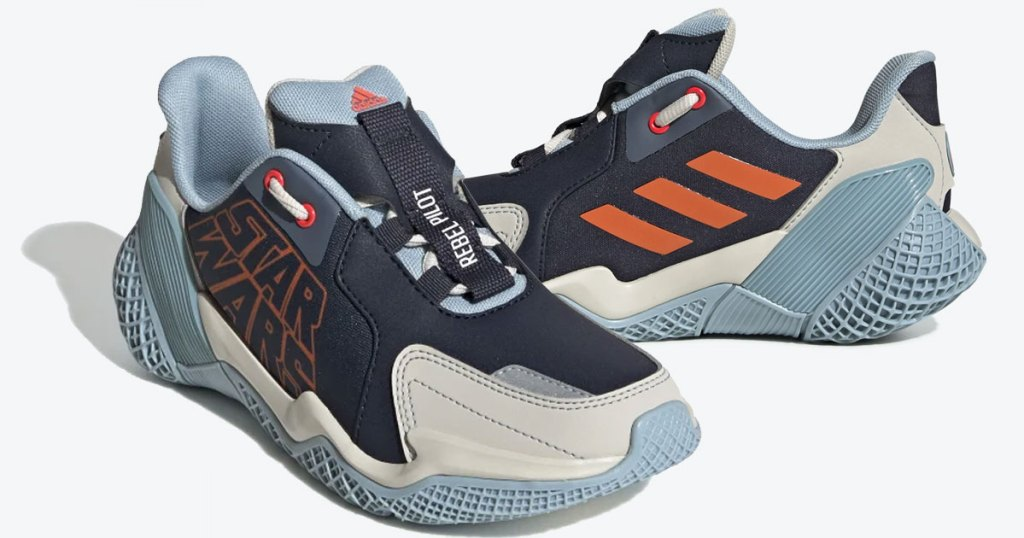 kids adidas sneakers in black and cream with orange star wars logo and blue rubber sole