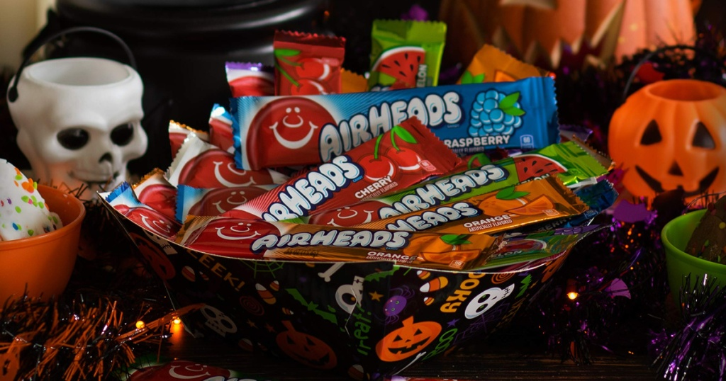 large bowl of full size AirHead Candy Bars surrounded by Halloween decor