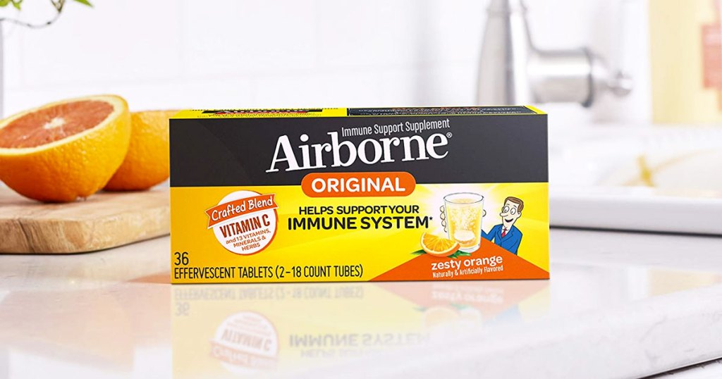 orange box of airborne tablets on kitchen counter near oranges