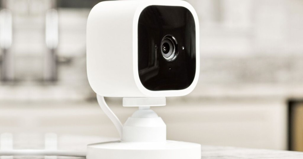 black and white mini security camera on a table