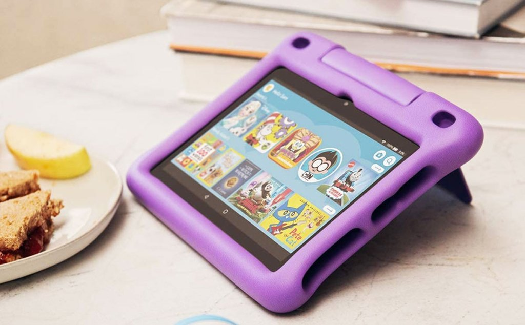 amazon fire kids tablet with purple case on a wood table