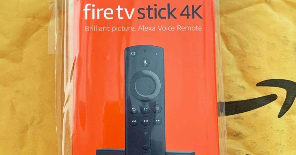 amazon fire tv stick 4k on a yellow amazon bubble mailer