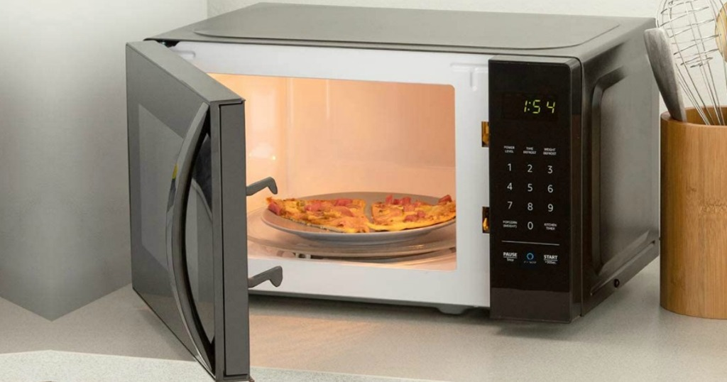 Small black microwave on a counter top with the door open