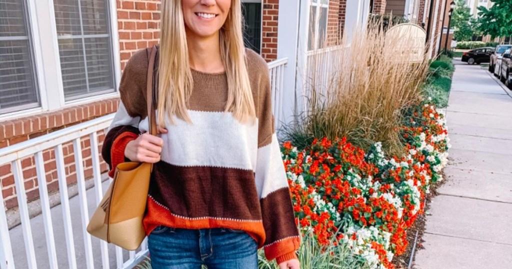 woman wearing striped sweater outdoors