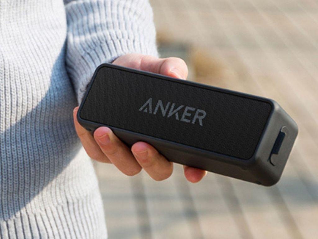 woman holding Anker Soundcore 2 Portable Bluetooth Speaker in Black