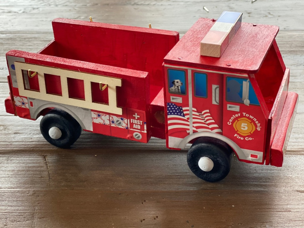red wooden fire truck