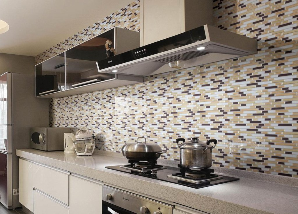 brown-toned peel and stick wall tiles on kitchen wall