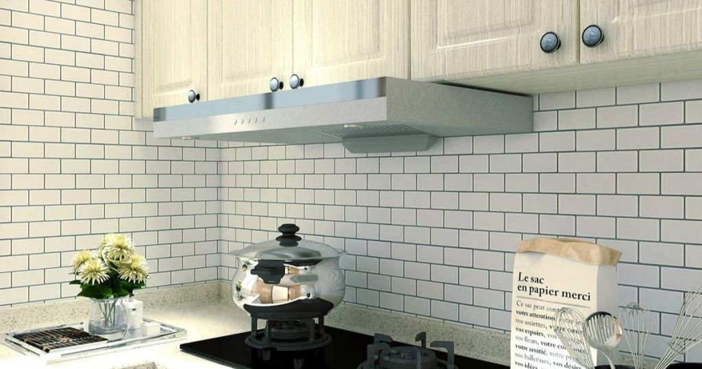 white subway tiles in kitchen behind stove