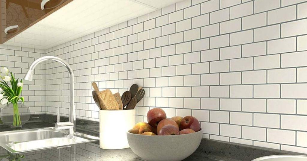 white subway tiles on kitchen wall behind sink
