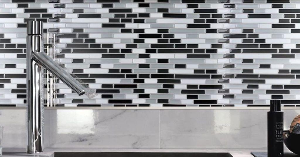 black white and gray backsplash tile behind sink