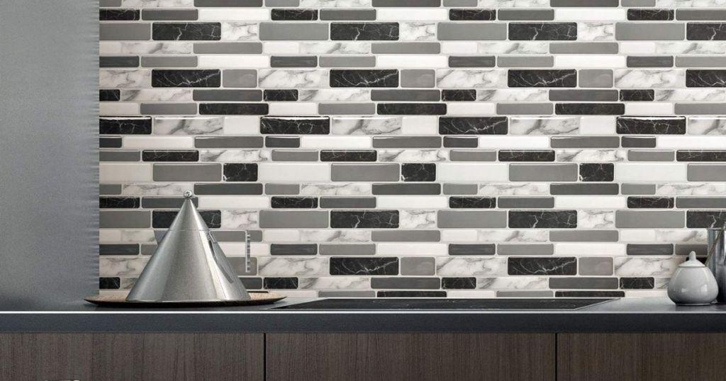 gray black and white backsplash tiles in office