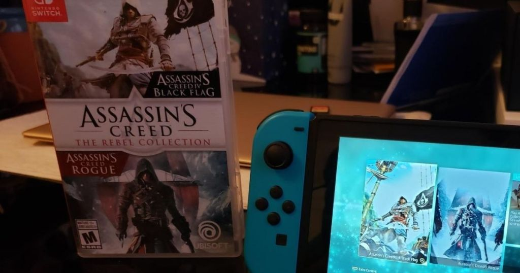 Assassin's Creed game next to a Nintendo Switch