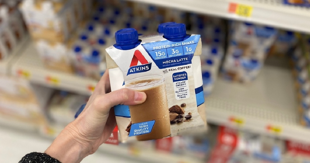 hand holding a Atkin Mocha Latte Protein shake 4 pack in store