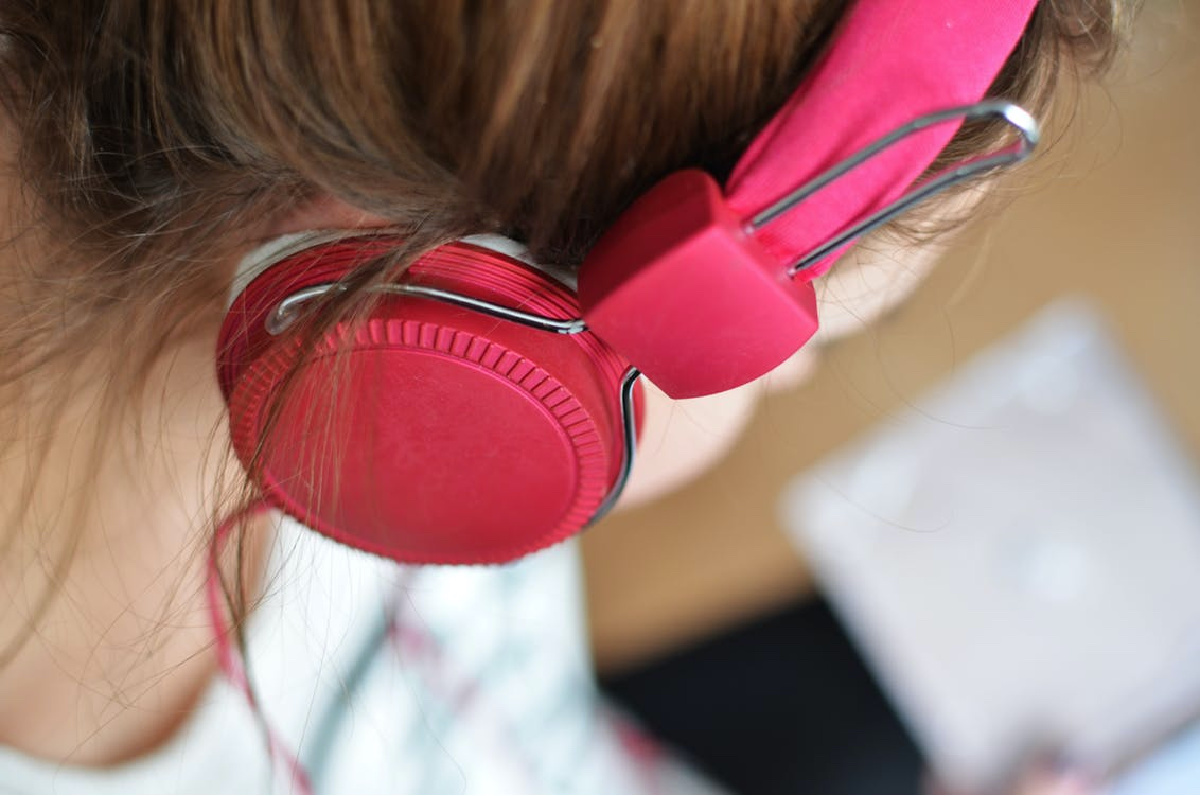 girl wearing pink headphones