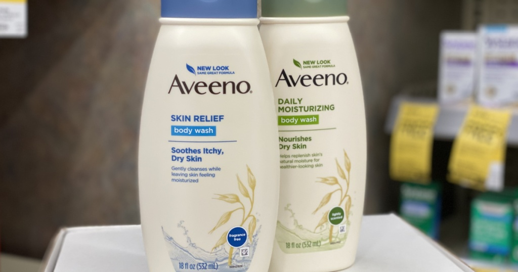 two aveeno body wash sitting next to each other on a shelf at walgreens