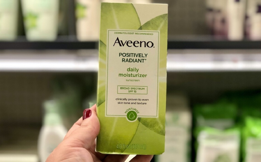 hand holding facial moisturizer in store