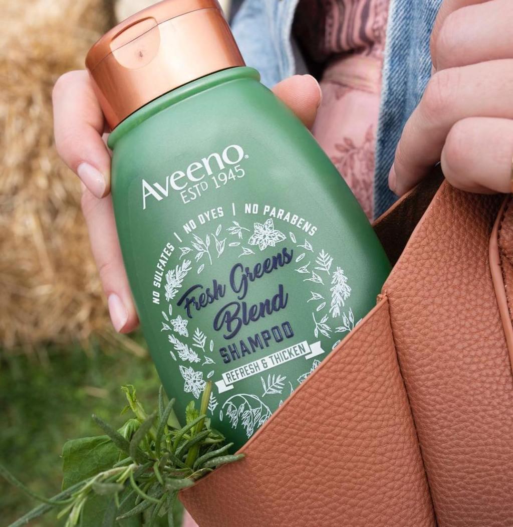 Aveeno Fresh Greens Blend Shampoo in a tote