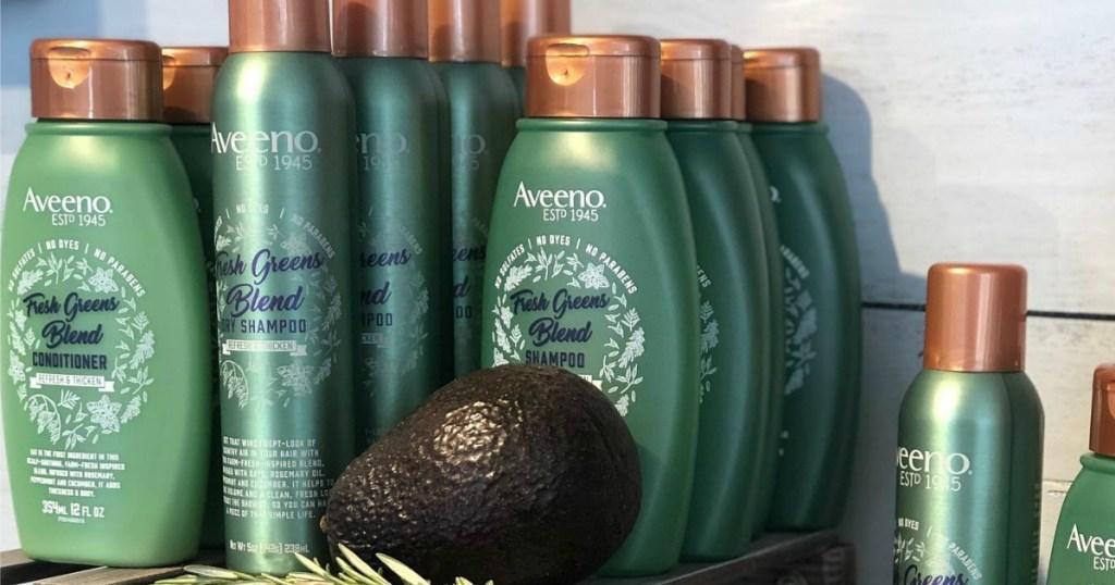 Aveeno Fresh Haircare stacked on table
