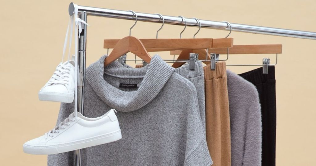 clothing on hangers on a rack