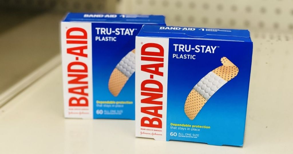 two boxes of band aids on shelf