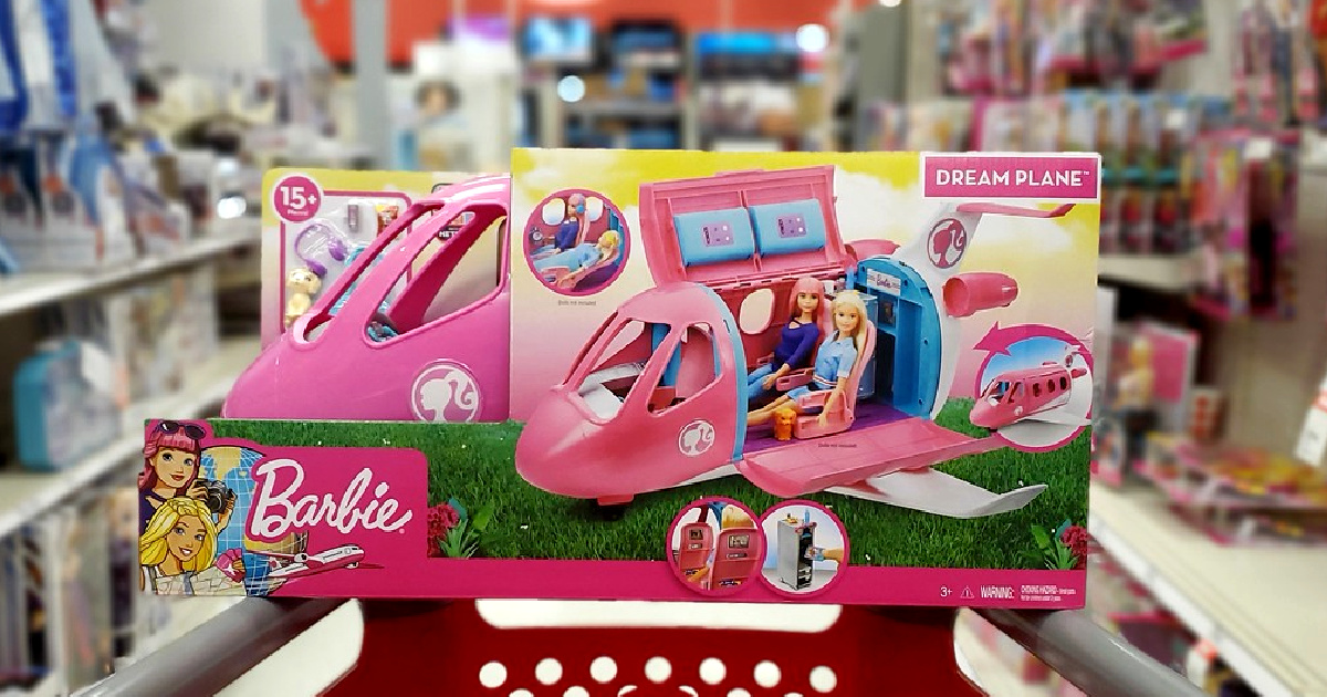 Barbie plane playset on red shopping cart in store