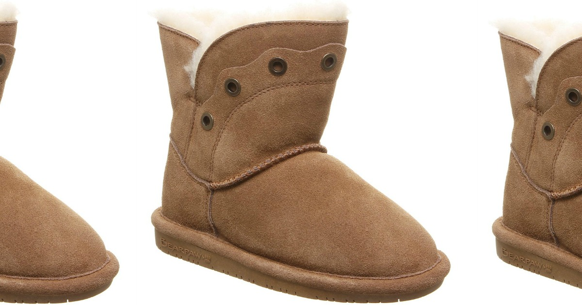 Three suede tan boots in a row