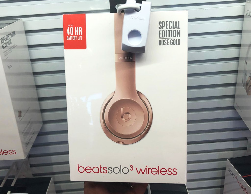 pair of rose gold beats solo3 headphones on store display