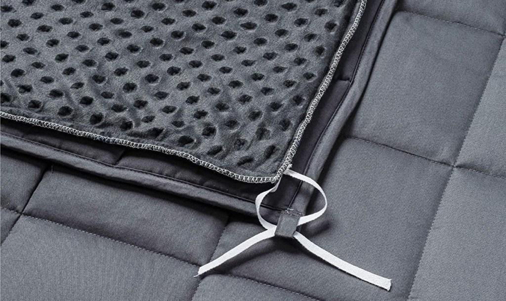 ties on the corner of a blanket