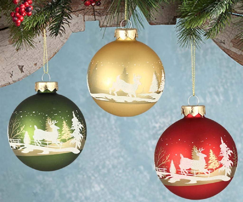 green, gold, and red ornaments with white holiday scenes