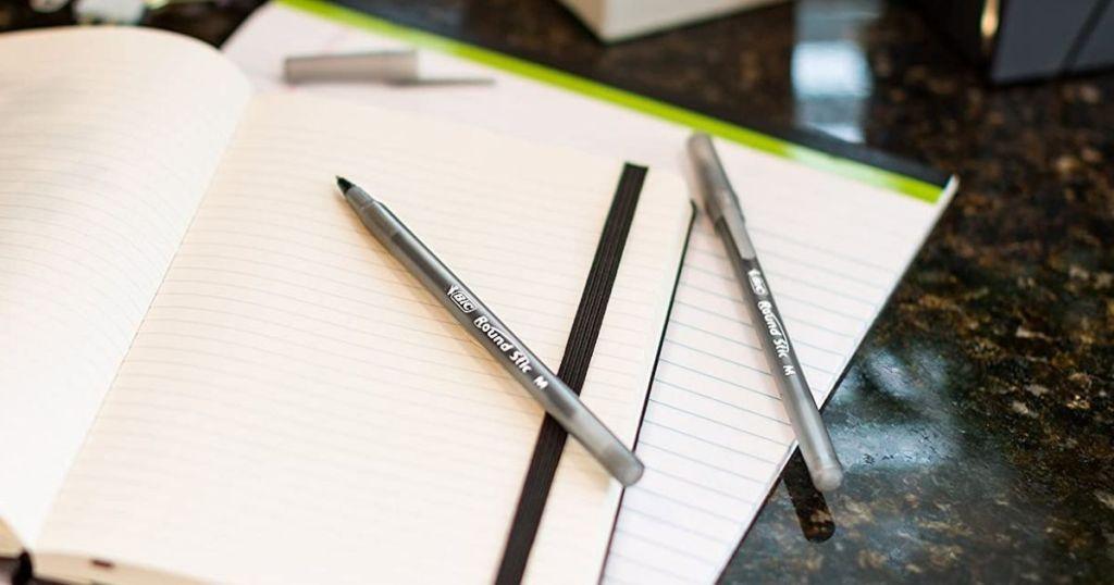 BIC Round Stick Pens on notebook