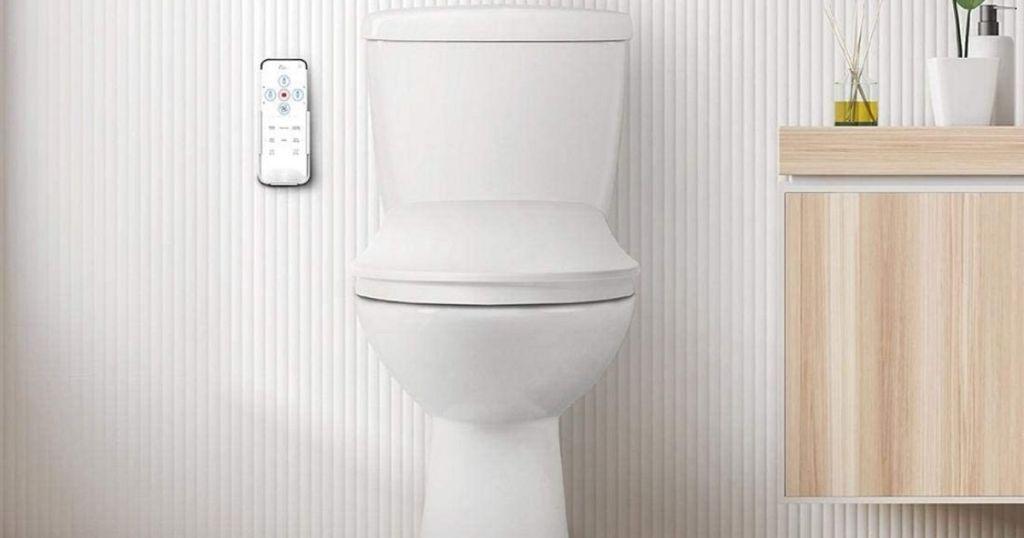 Toilet with bidet remote in bathroom