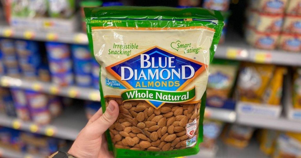hand holding a bag of Blue diamond almonds