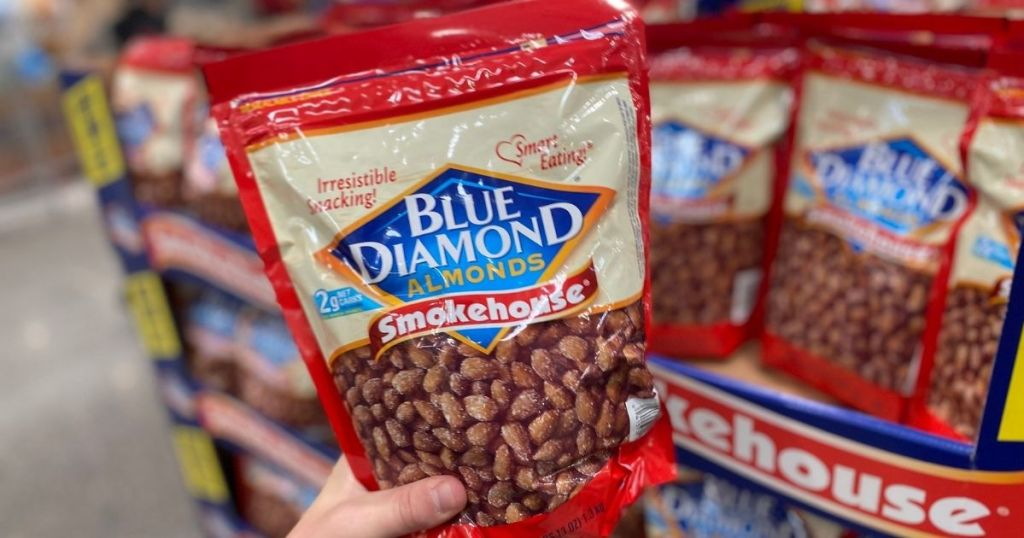 hand holding a bag of Blue Diamond almonds